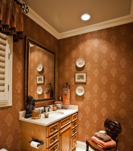 This cinnamon printed wall covering adds a decidedly masculine feel to this guest bathroom.