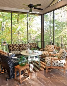 Screened in porch with wicker chairs and sofa, Nashville interior design by Eric Ross Interiors, interior designers for your next project, call today!