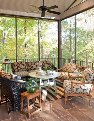 Screened in porch with wicker chairs and sofa, Nashville interior design by Eric Ross Interiors