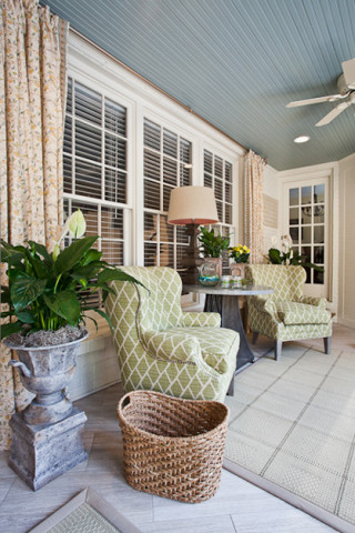 Basket on a sunporch, interior design in Nashville, TN by Eric Ross interiors.