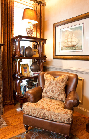 Pairing leather and fabric on a club chair, interior design in Nashville by Eric Ross Interiors.