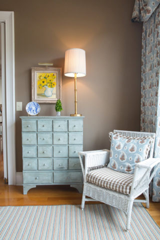 White wicker chair paired with painted chest, Nashville interior designers, Eric Ross Interiors