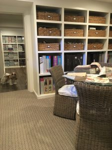 Wicker and rush storage baskets, interior design in Nashville, TN by Eric Ross, picture of his Nashville interior design studio.