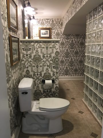 Baroque paisley wallpaper in the bathroom, interior design in Nashville, TN by interior designer, Eric Ross.