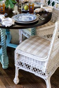 Wicker chair with table setting, top interior designer in Nashville, TN, Eric Ross Interiors shares interior design and décor photo.