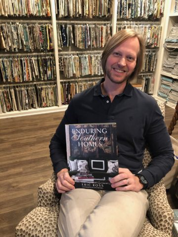 Eric Ross holding his book, Enduring Southern Homes, for interior design in Nashville call Eric Ross Interiors today!