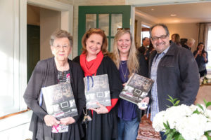 People holding Eric Ross's Enduring Southern Homes book, Nashville interior design by Eric Ross Interiors