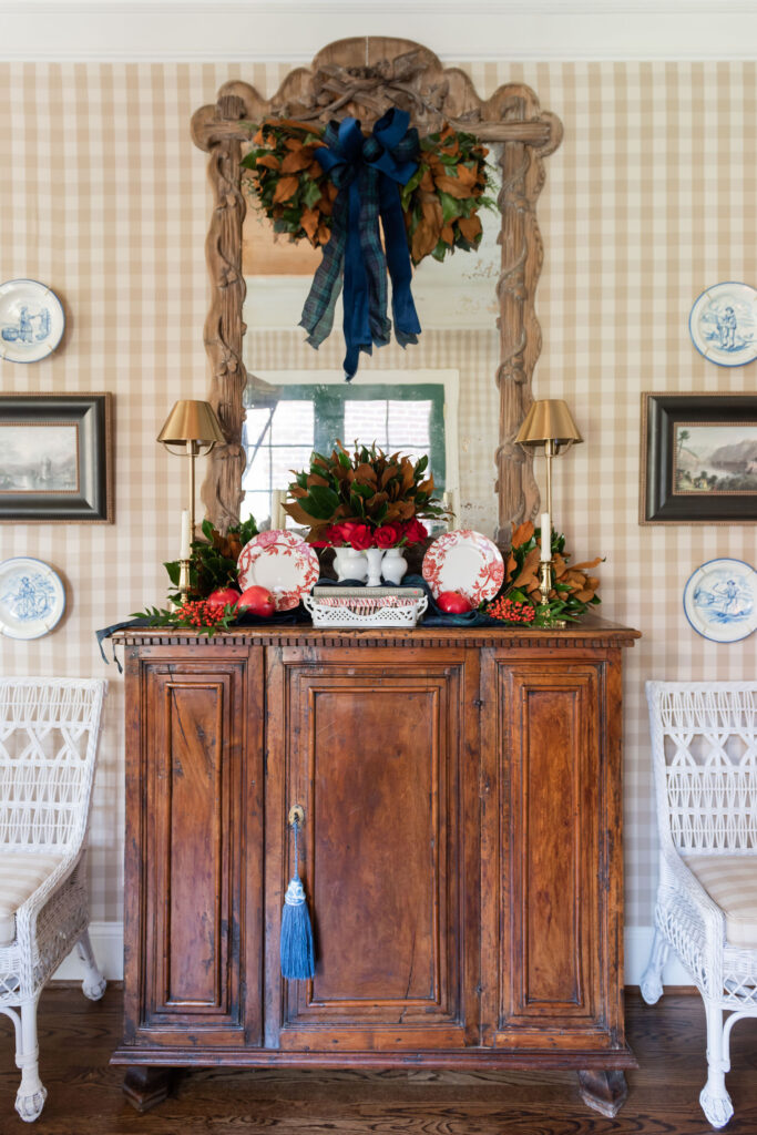 Sideboard and mirror holiday display and interior design in Nashville, TN by Eric Ross Interiors.