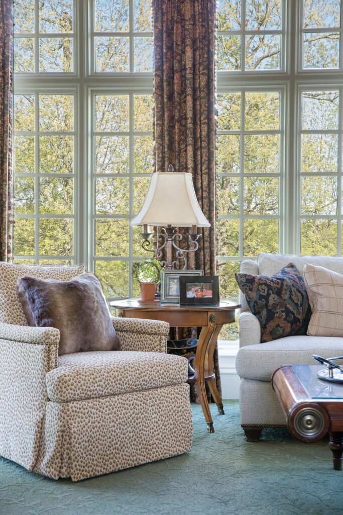 Living room sofa, chair and window treatment done by best interior designer in Nashville, TN, Eric Ross.