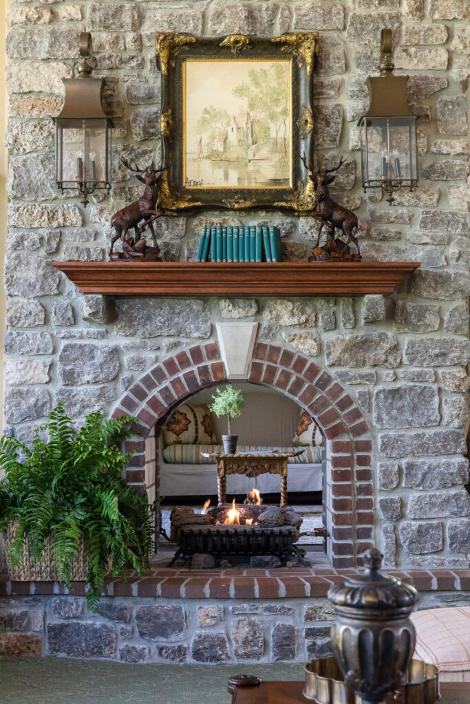 Stone fireplace surround and interior design in Nashville, TN by Eric Ross Interiors.