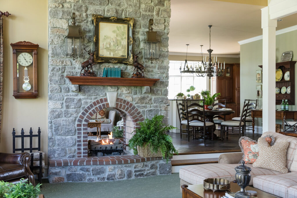Great room stone look through fireplace by Nashville interior design firm Eric Ross Interiors.