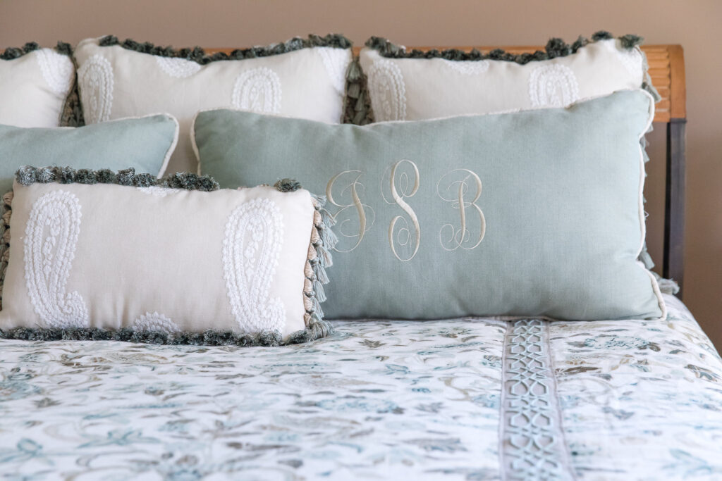 Master Bed Monogrammed pillows and interior design by Nashville interior designers, Eric Ross Interiors.