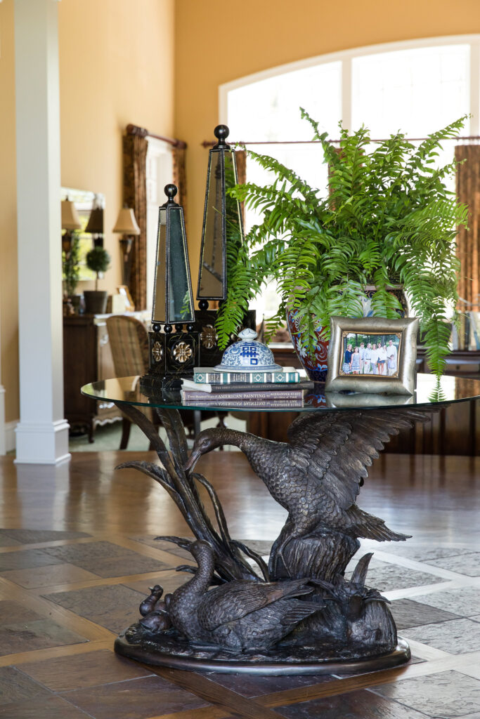 Bronze table base in foyer selected by Nashville interior designers before the home was finished - Eric Ross Interiors.